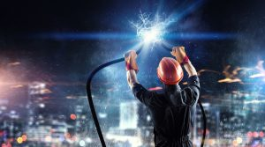 Electrician man joining cable presenting power and energy concept