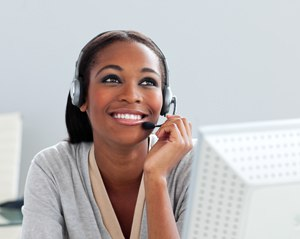 Afro-american businesswoman using headset in the office
